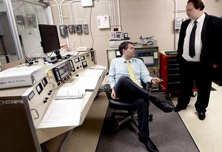 In this August 15, 2014, file photo, nuclear engineers Kelly Jordan, left, and James Baciak talk in the control room of the nuclear reactor at the University of Florida in Gainesville. Matt Stamey/The Gainesville Sun